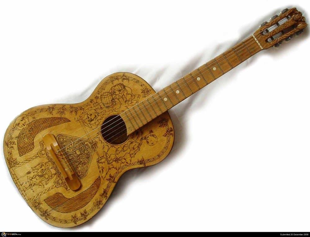 gitara.thumb.jpg.a0ca414a82e5008433b4d576014deb10.jpg